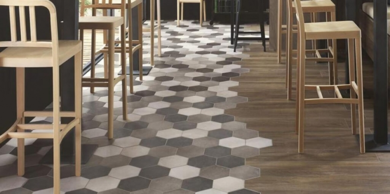 the wedding of cement tile to parquet in a restaurant