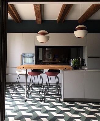 hexagon cement tile on the floor in a kitchen by Cement Tiles Co in Liverpool