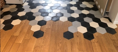 kitchen floor with black and white hexagonal cement tiles