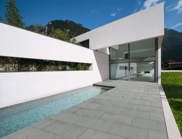 Swimming pool with stone effect tiles