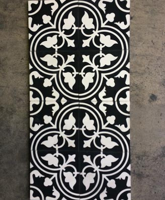 Black and white cement tiles in a hall of London England Cimenterie de la Tour