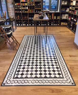 Shop in classic geometric cement tiles in London England, Cimenterie de la Tour