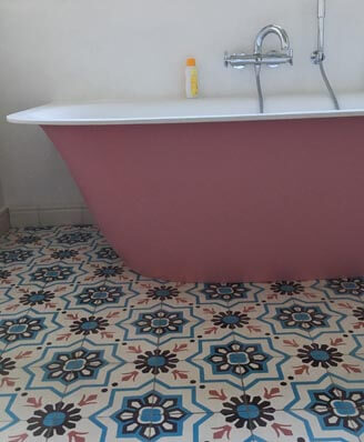 Bathroom in old and floral cement tiles in Nottingham England
