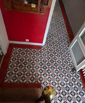 Hall in geometric cement tiles in London, Cimenterie de la Tour