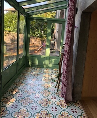 Old and colored cement tiles in a veranda in Sheffield by Cimenterie de la Tour