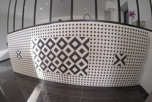 Modern and geometric cement tiles wall in London by Cement tils Co
