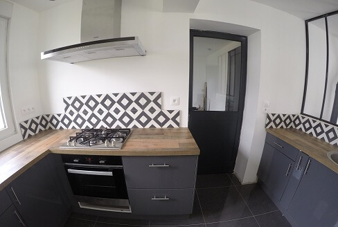 Kitchen wall in geometric cement tiles in Sheffield by Cimenterie de la Tour